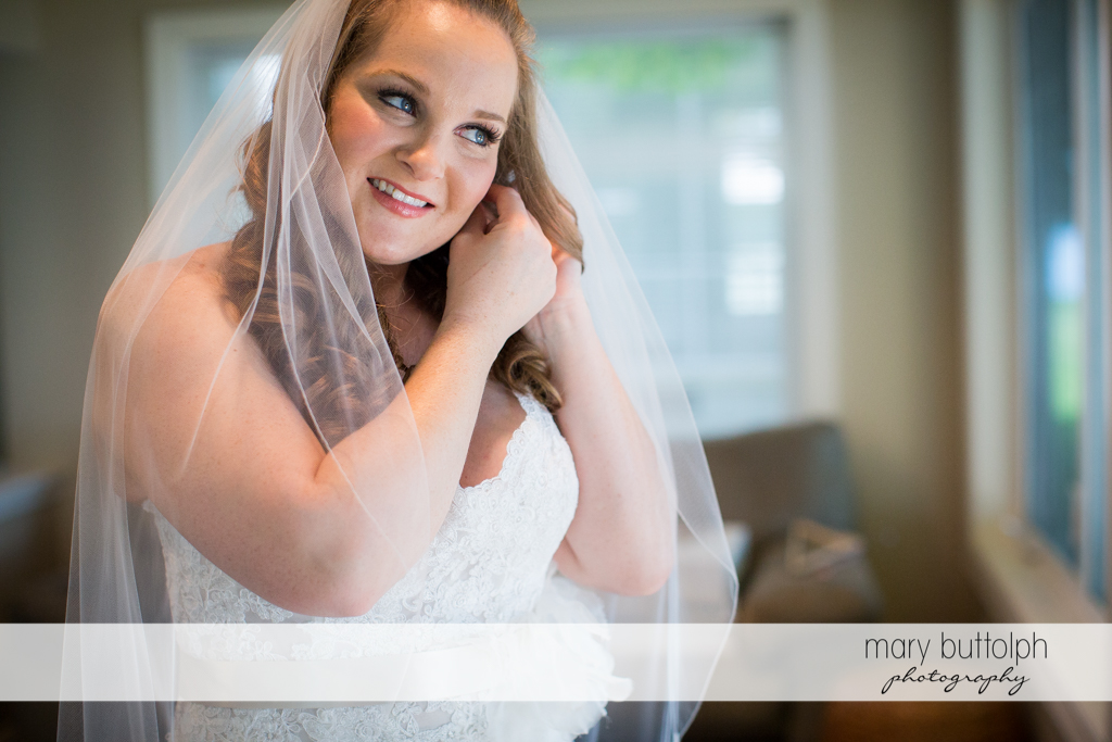 Bride wears her earring at Emerson Park Pavilion Wedding