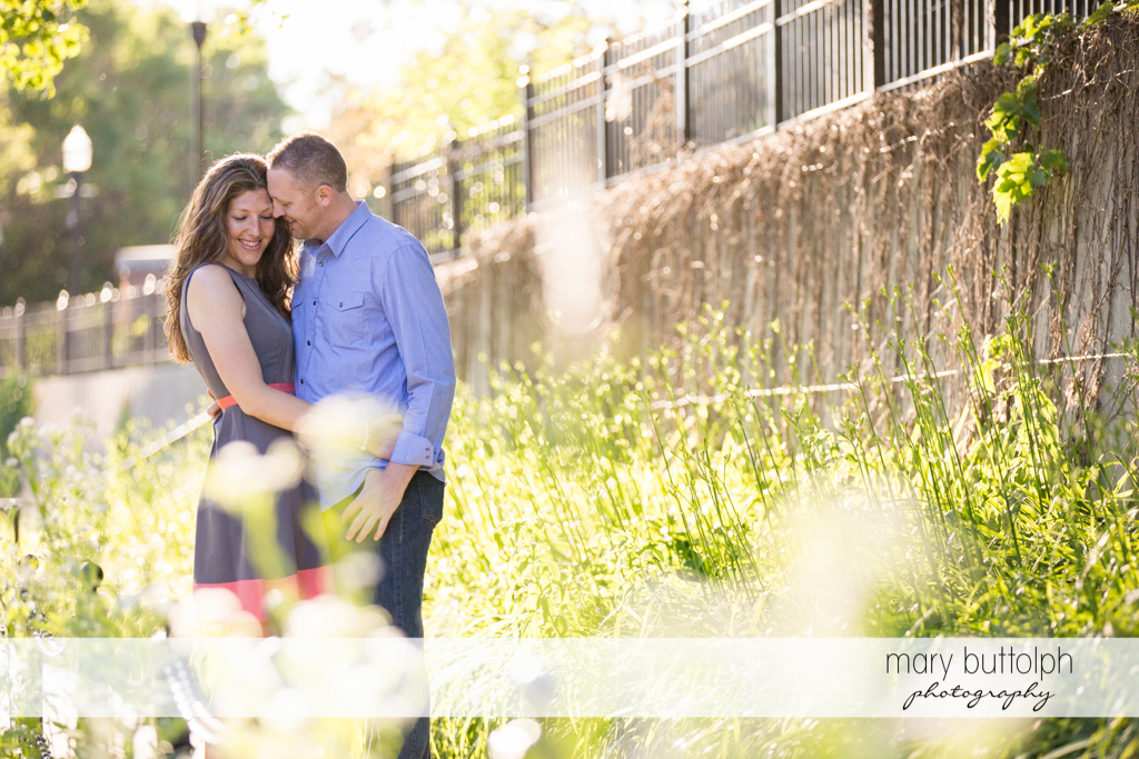 Couple pose in the garden at Franklin Square Engagement
