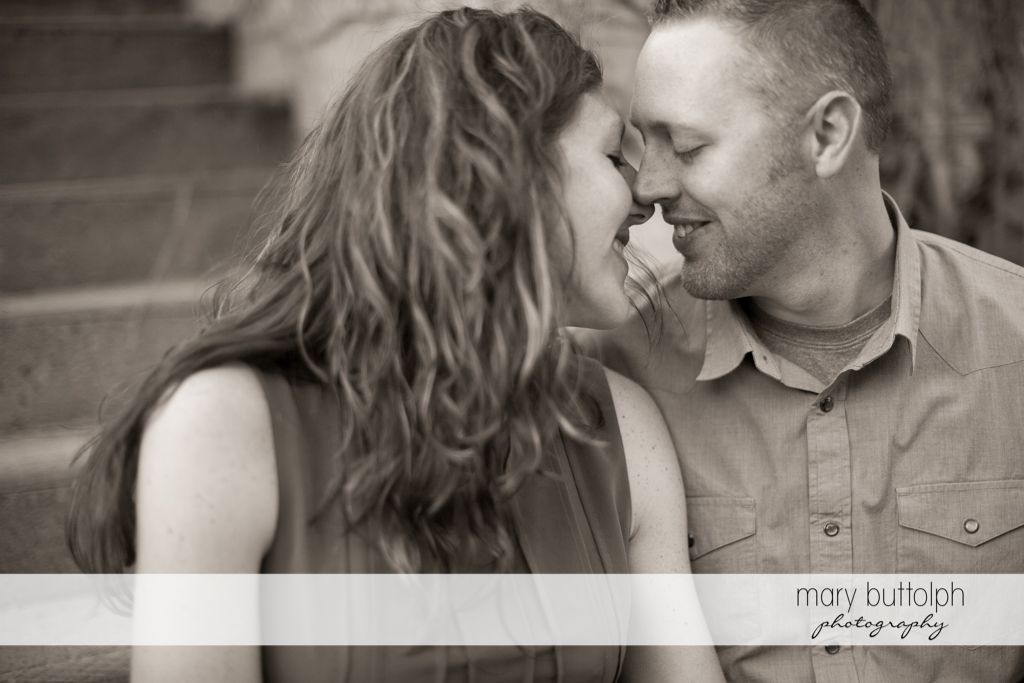 Couple rub noses in this black and white shot at Franklin Square Engagement