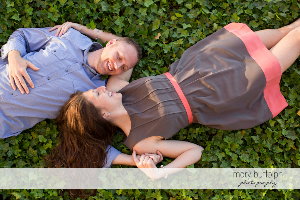 Couple lie in the garden at Franklin Square Engagement