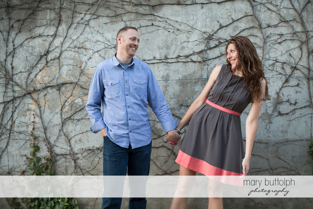 Woman looks surprised in this funny shot in front of a concrete wall at Franklin Square Engagement