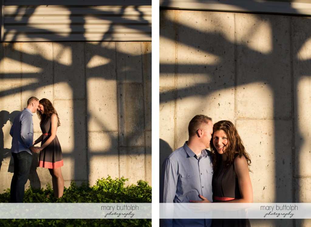 Couple stand near a concrete wall at Franklin Square Engagement