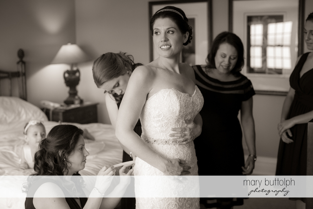 Bride looks great in her wedding gown thanks to her friends at the Inns of Aurora Wedding