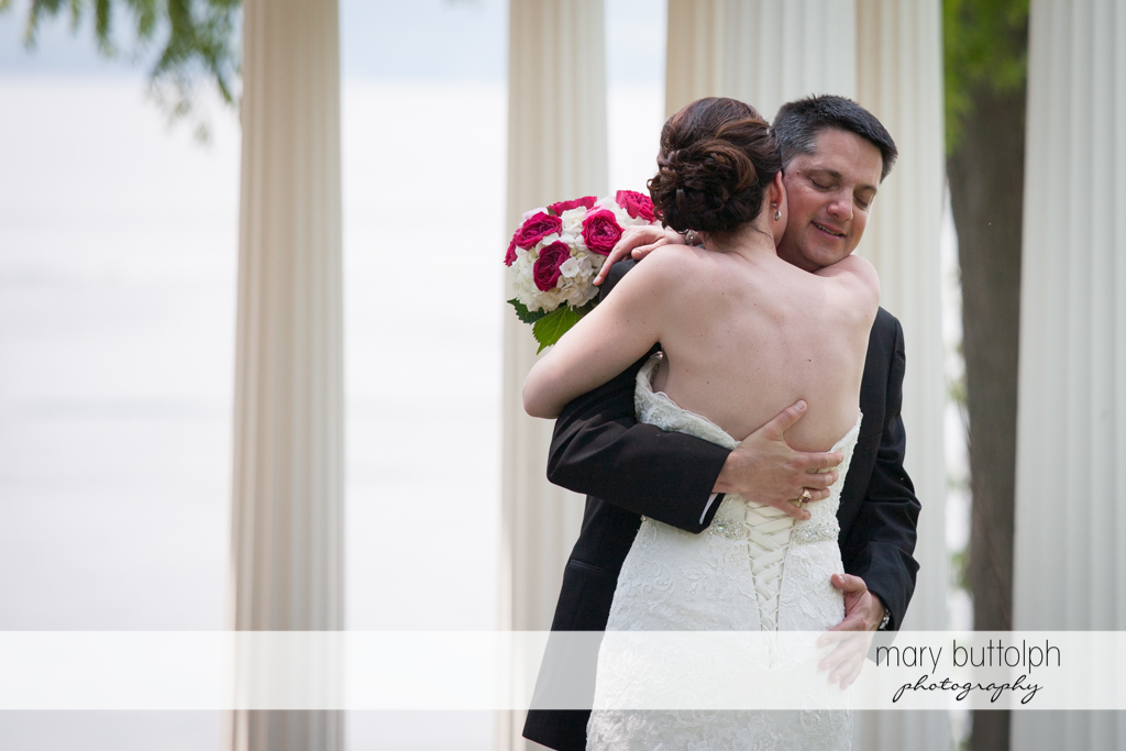 Couple embrace at the Inns of Aurora Wedding