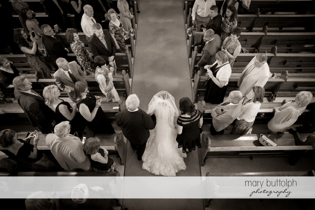 Overhead shot of the bride and her parents walking down the aisle at the Inns of Aurora Wedding