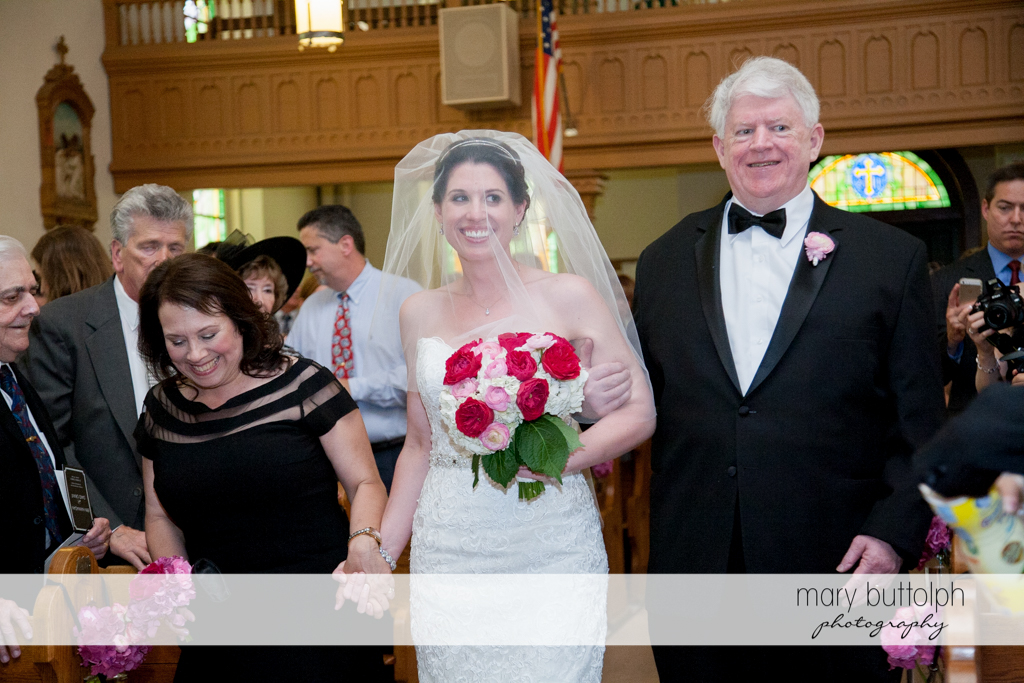 The bride and her parents on their way to the altar at the Inns of Aurora Wedding