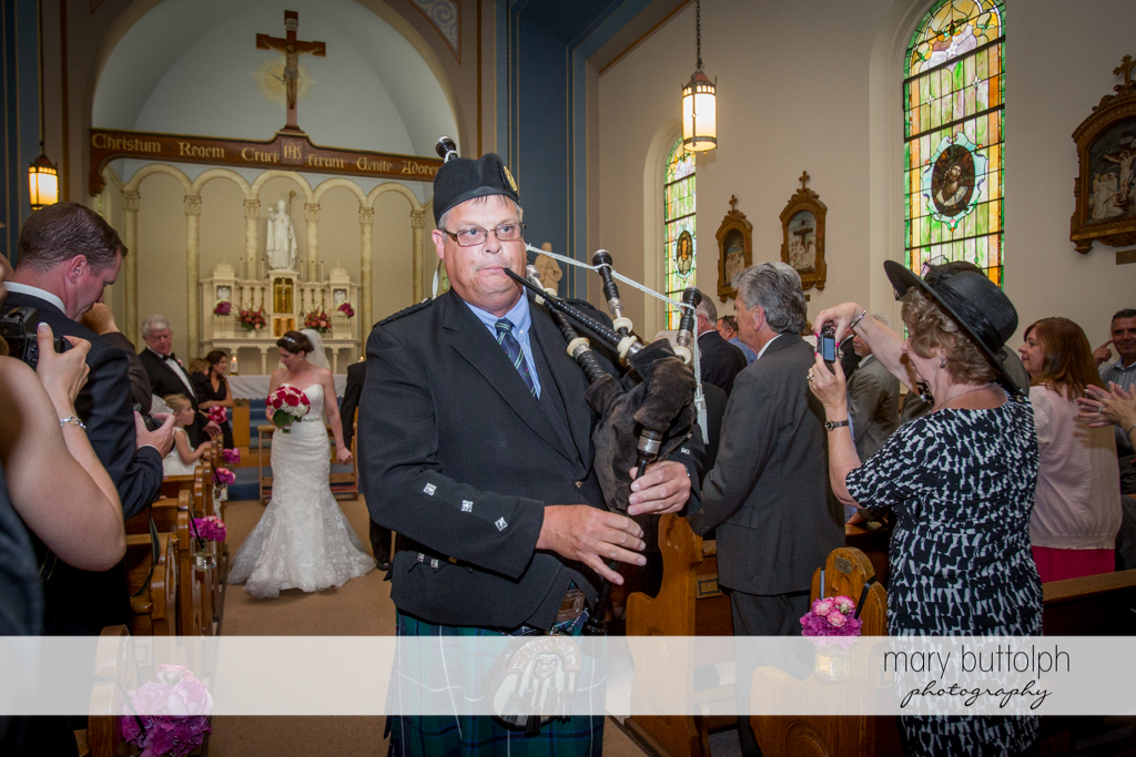 Bagpipe player in church at the Inns of Aurora Wedding