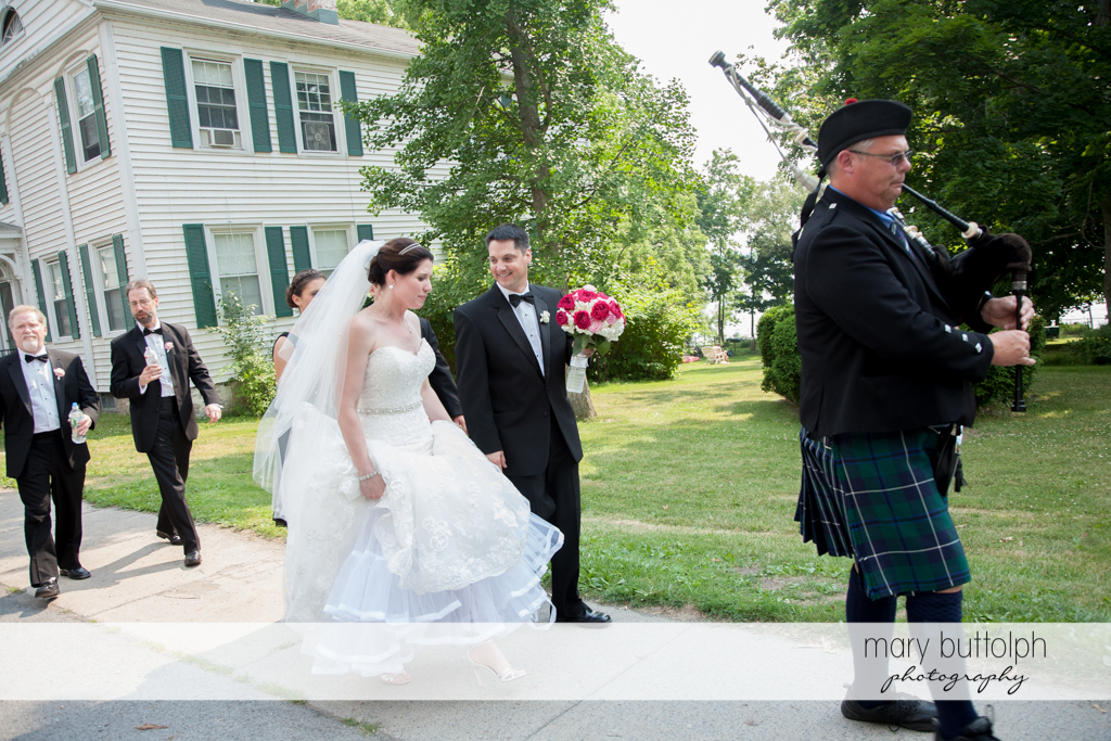 Bagpipe player leads the way for the wedding party at the Inns of Aurora Wedding
