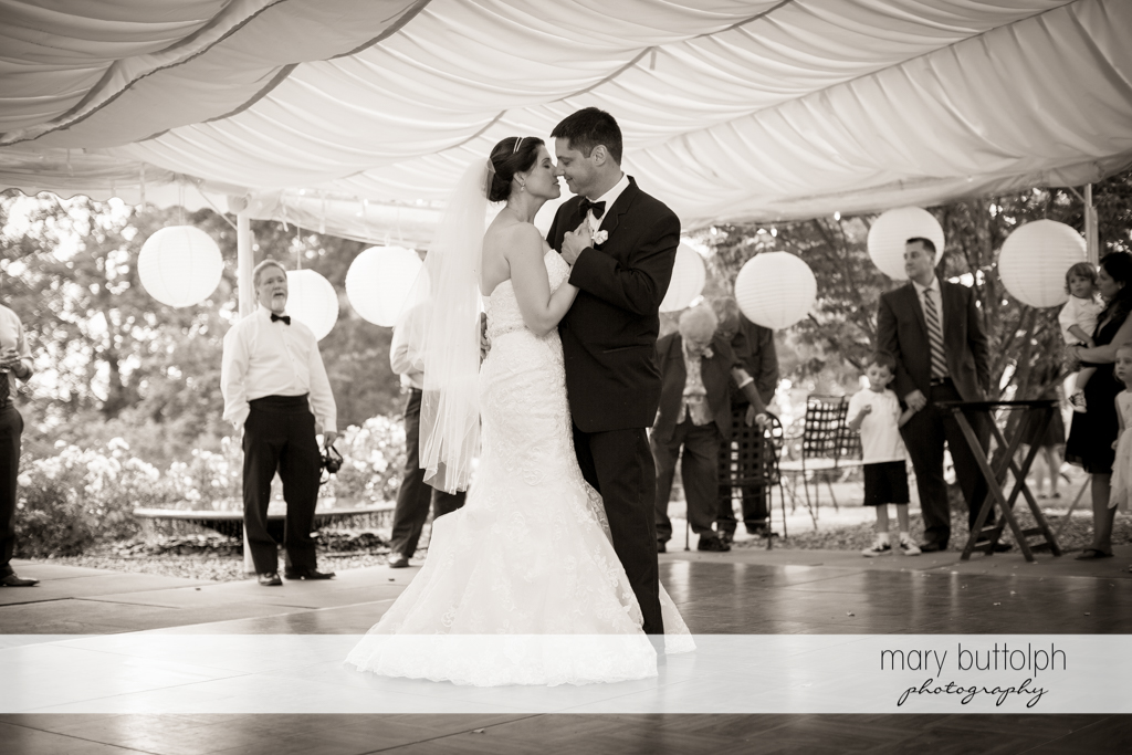 Couple dance in the wedding tent at the Inns of Aurora Wedding