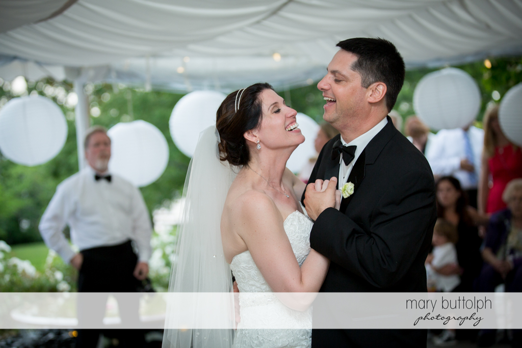 Couple laugh while dancing at the Inns of Aurora Wedding