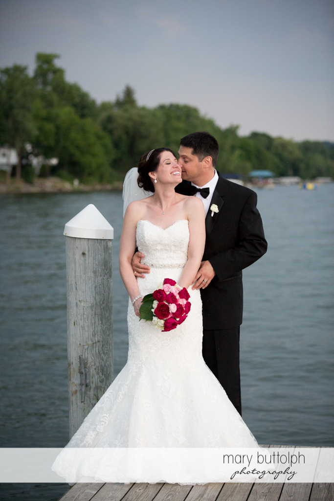 Couple stand in front of the lake at the Inns of Aurora Wedding