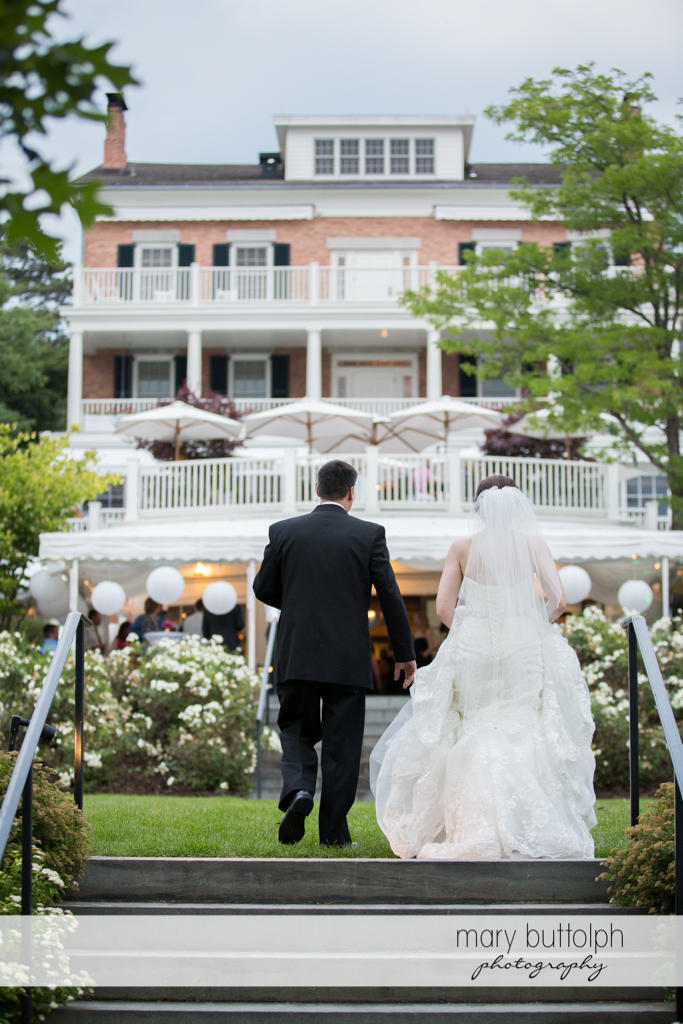 Couple approach the wedding venue at the Inns of Aurora Wedding