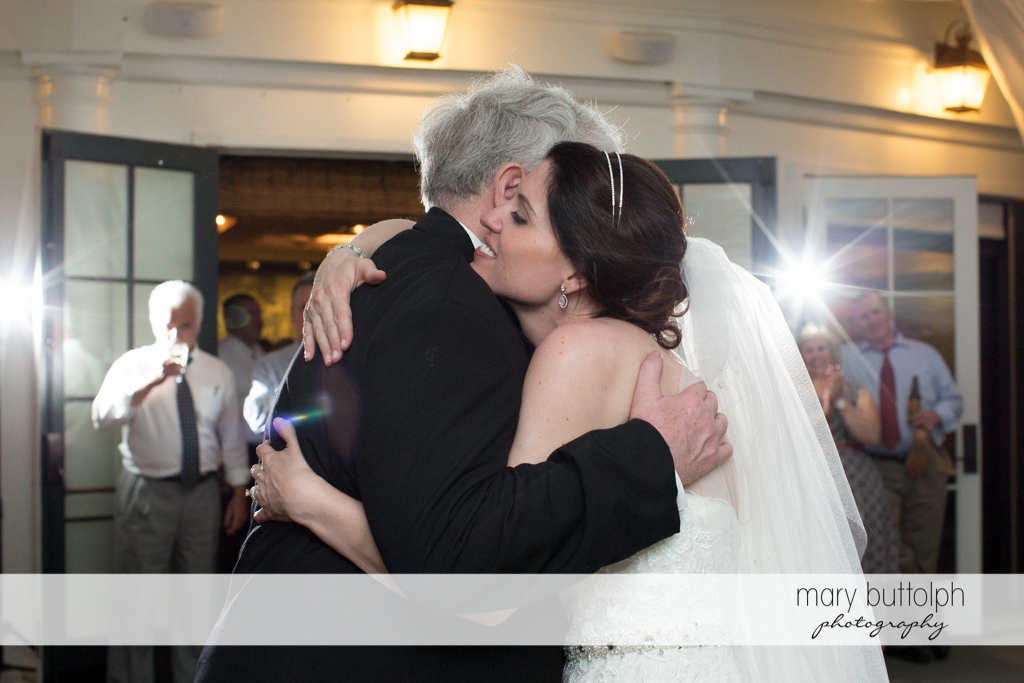 Bride hugs her father at the Inns of Aurora Wedding
