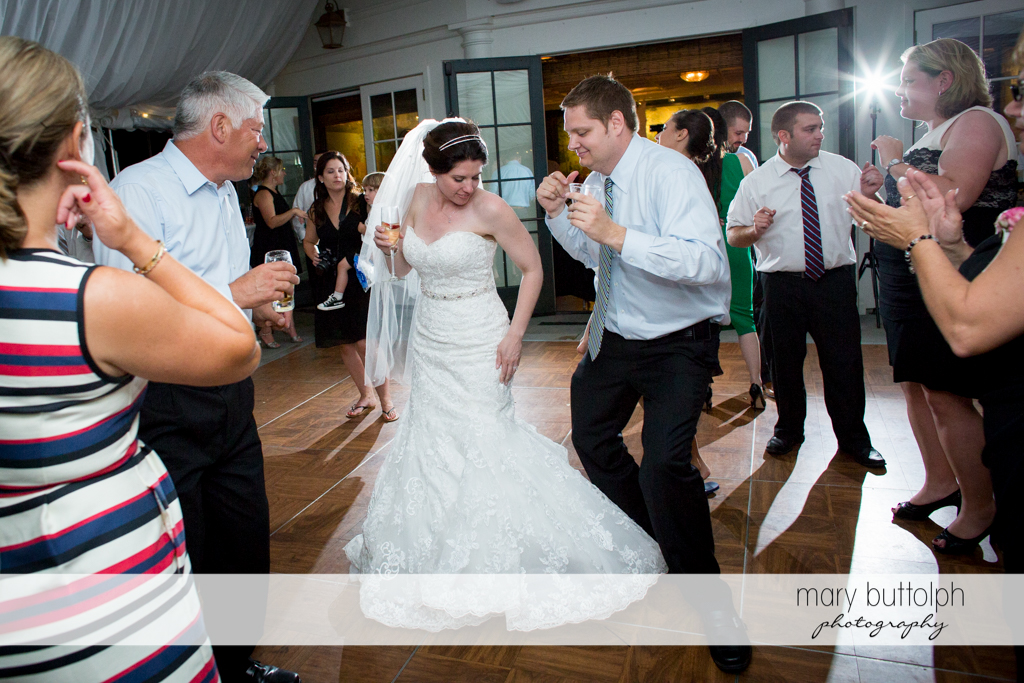 Couple show their dance moves to guests at the Inns of Aurora Wedding