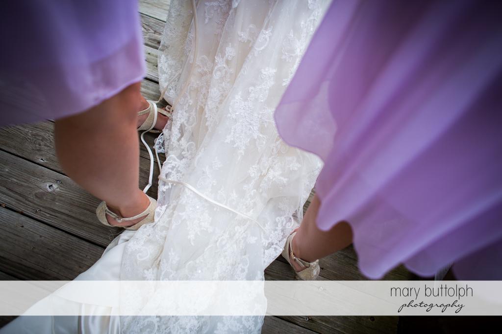 Bride's wedding gown covers the bridesmaids' feet at the Mirbeau Inn & Spa Wedding