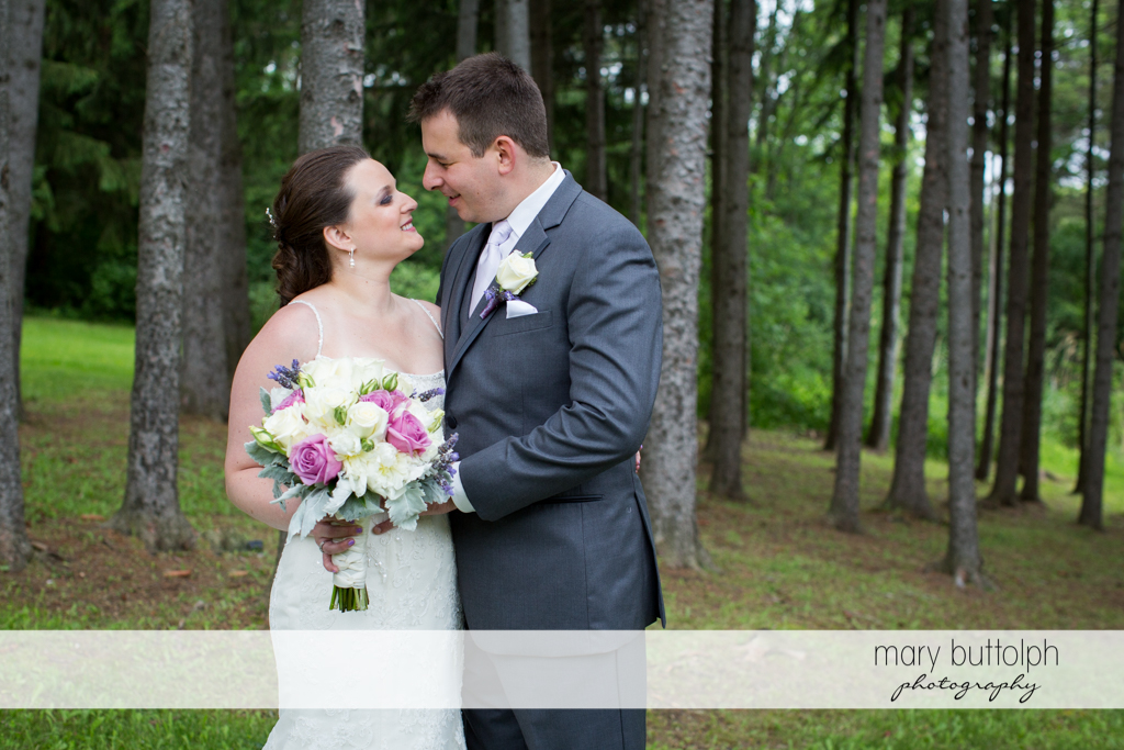 Couple see eye to eye in the woods at the Mirbeau Inn & Spa Wedding