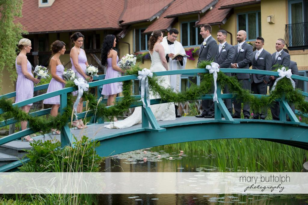 Couple's bridge wedding at the Mirbeau Inn & Spa Wedding