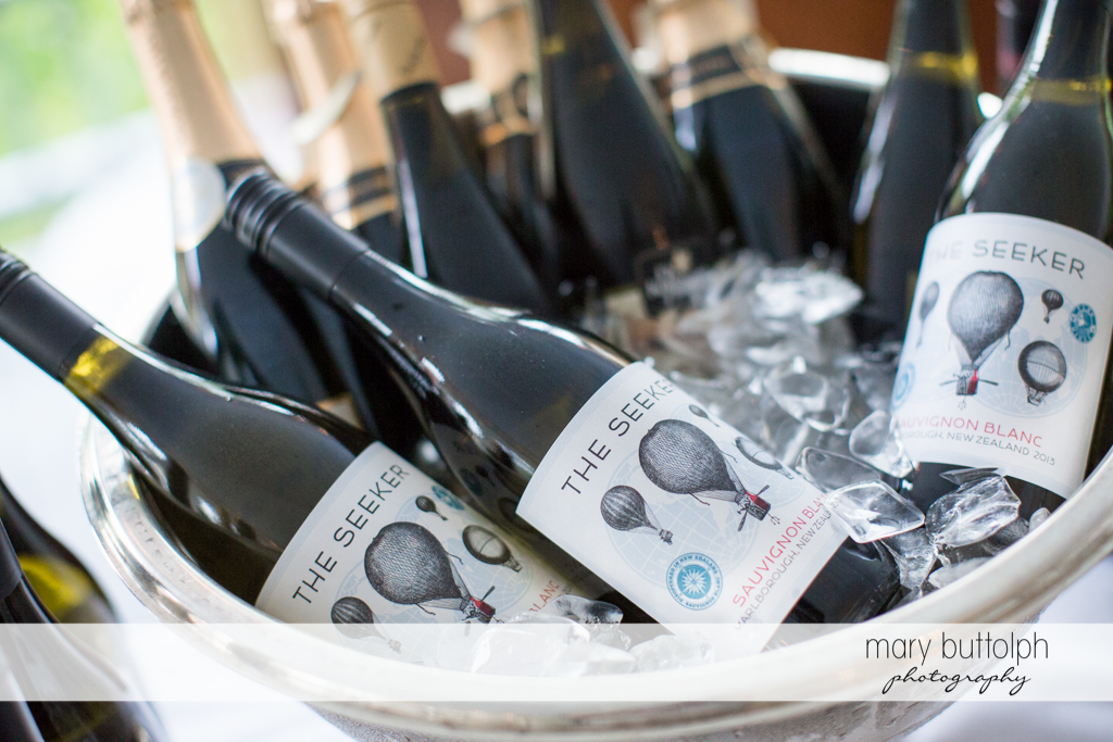 Bottles of wine at the wedding venue at the Mirbeau Inn & Spa Wedding