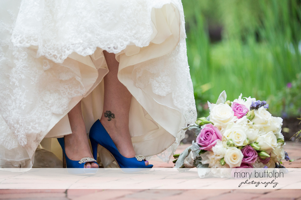Bride's tattoo, blue wedding shoes, and bouquet at the Mirbeau Inn & Spa Wedding