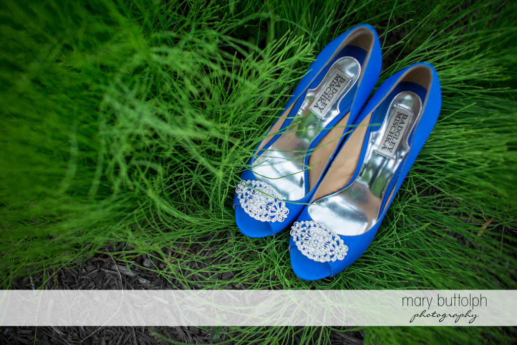 The bride's wedding shoes on the grass at the Mirbeau Inn & Spa Wedding