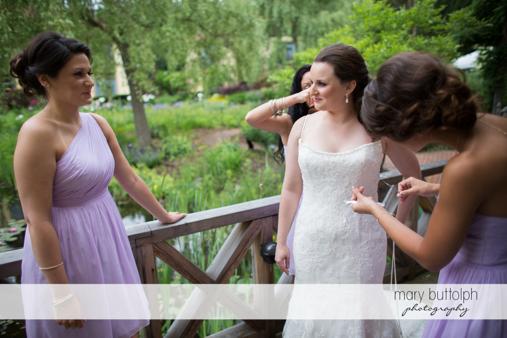 Bride and her guests relax on the porch at the Mirbeau Inn & Spa Wedding
