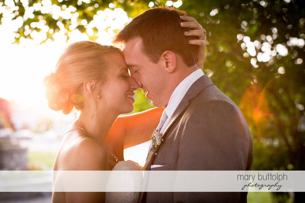 Couple rub noses in the garden at the Sherwood Inn Wedding