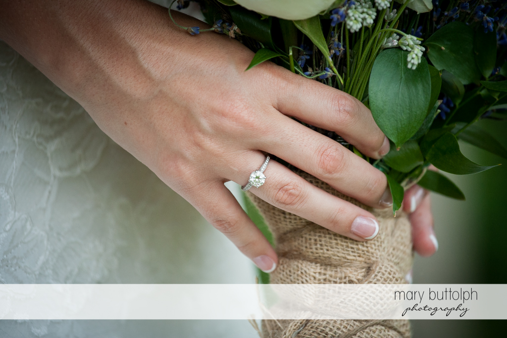 Close up shot of the bride's wedding ring and her bouquet at the Sherwood Inn Wedding