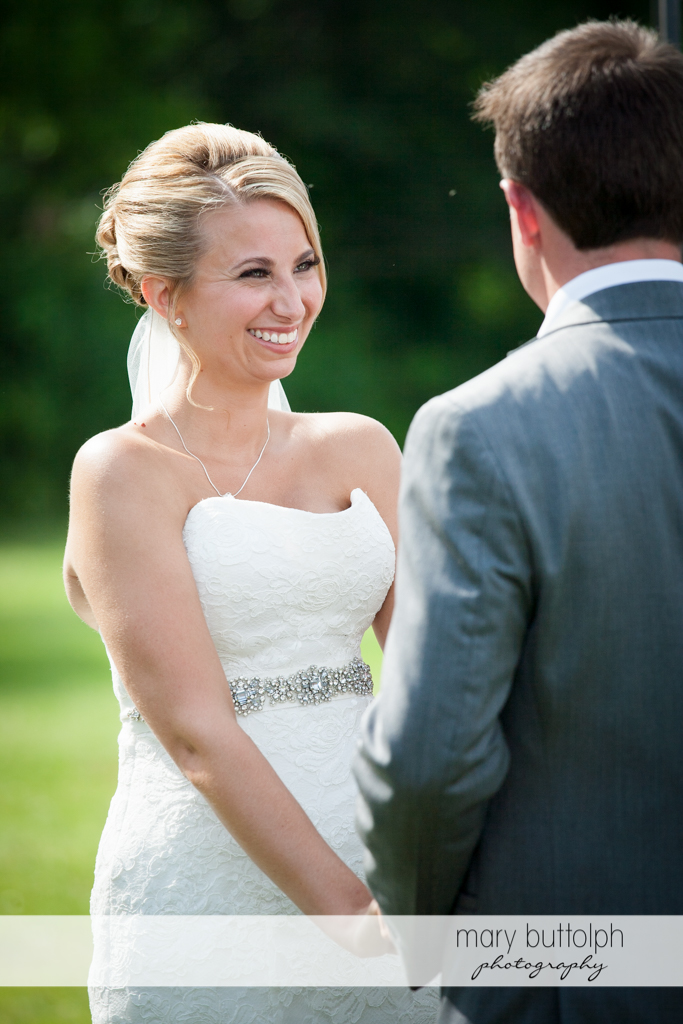 Bride smiles at the groom at the Sherwood Inn Wedding