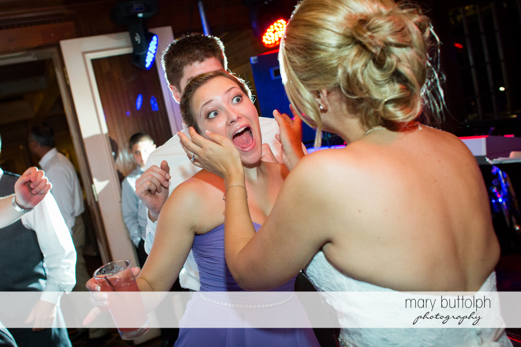 Bridesmaid looks surprised after talking to the bride at the Sherwood Inn Wedding