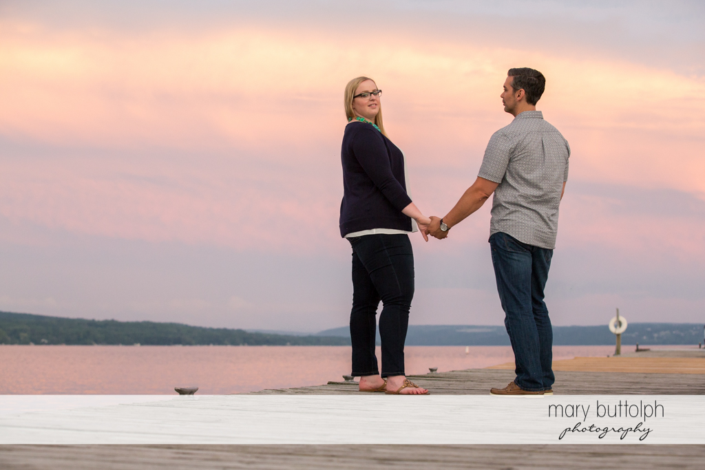 Couple stand near the lake at Skaneateles Engagement
