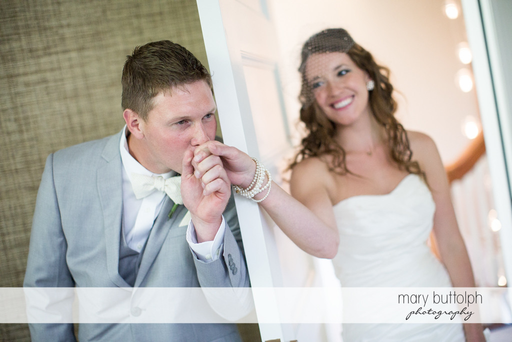 Groom kisses the bride's hand at the Inns of Aurora Wedding