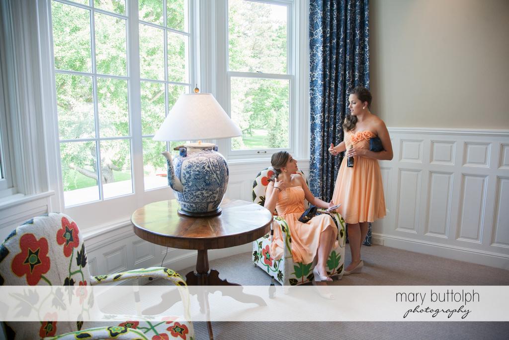 Bridesmaids talk at the lobby of the Inns of Aurora Wedding