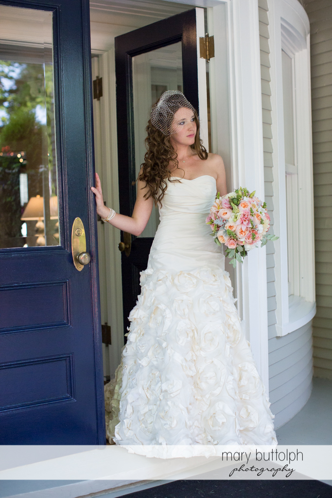 Bride poses at the doorway at the Inns of Aurora Wedding