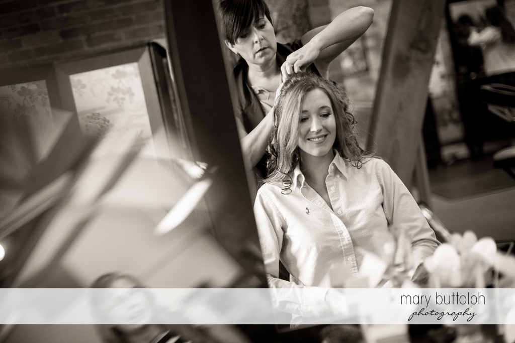 Bride's hair is styled by a friend at the Inns of Aurora Wedding