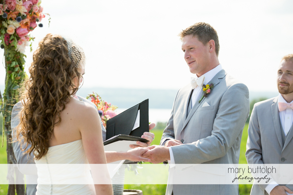 Couple hold hands during the wedding ceremony at the Inns of Aurora Wedding