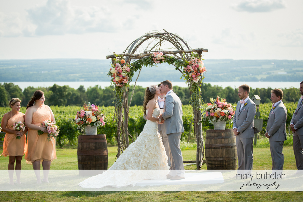Couple kiss in the garden at the Inns of Aurora Wedding