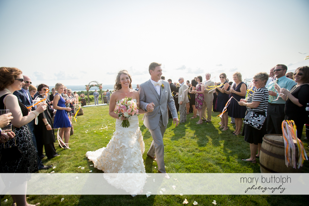 Couple leave the garden after the wedding ceremony at the Inns of Aurora Wedding