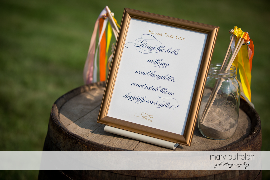 Sign tells guests what to do with the bells at the Inns of Aurora Wedding