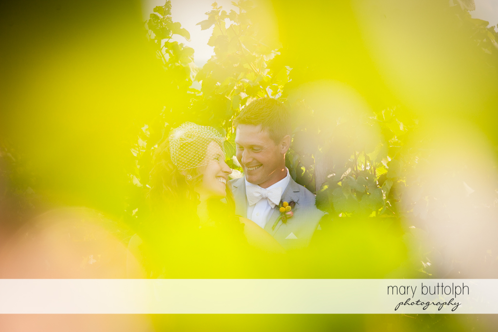 Trick shot of the couple in the vineyard at the Inns of Aurora Wedding