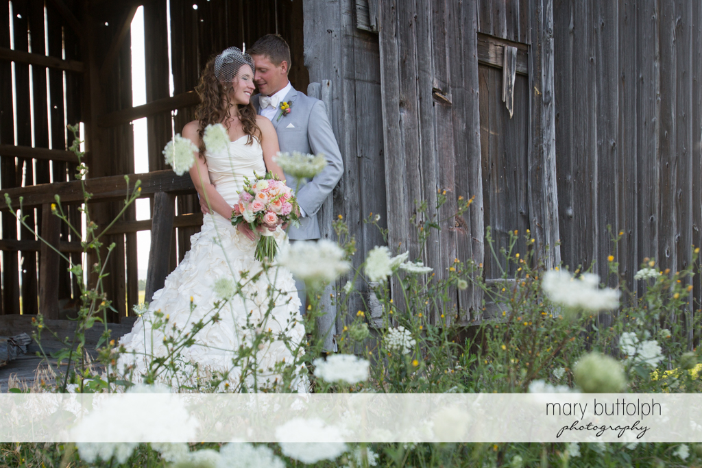 Couple in front of an old barn at the Inns of Aurora Wedding