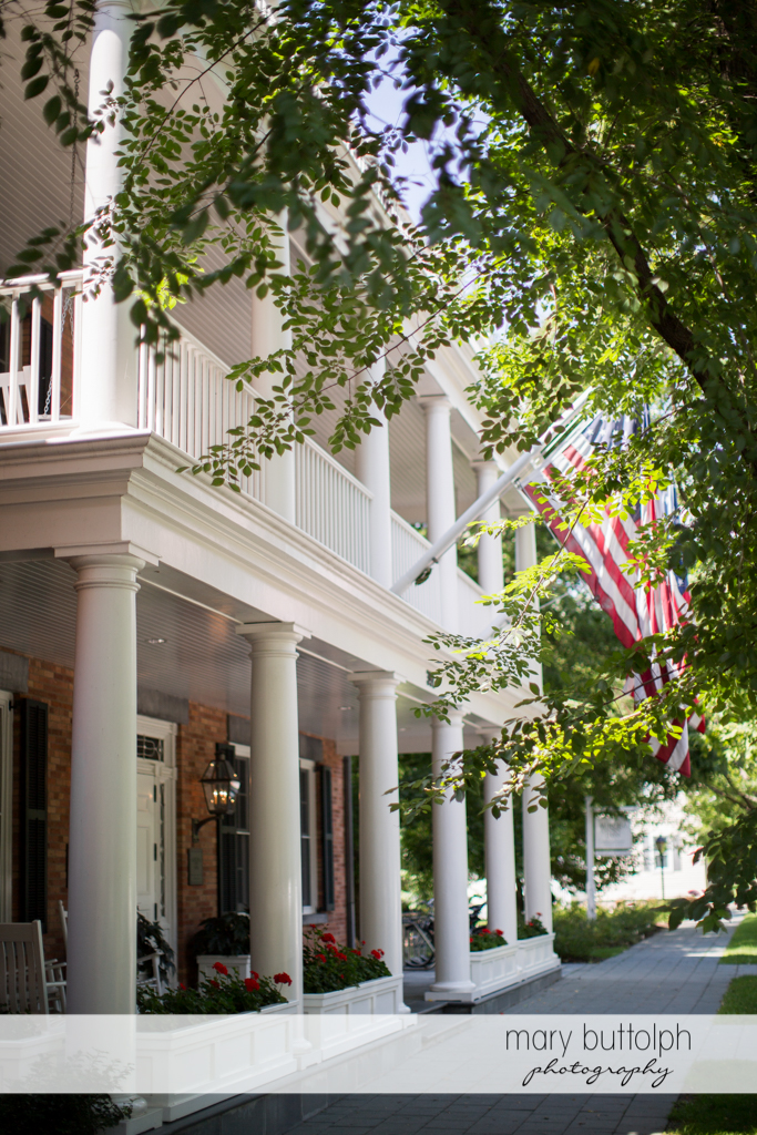 Facade of the wedding venue with the American flag at the Inns of Aurora Wedding