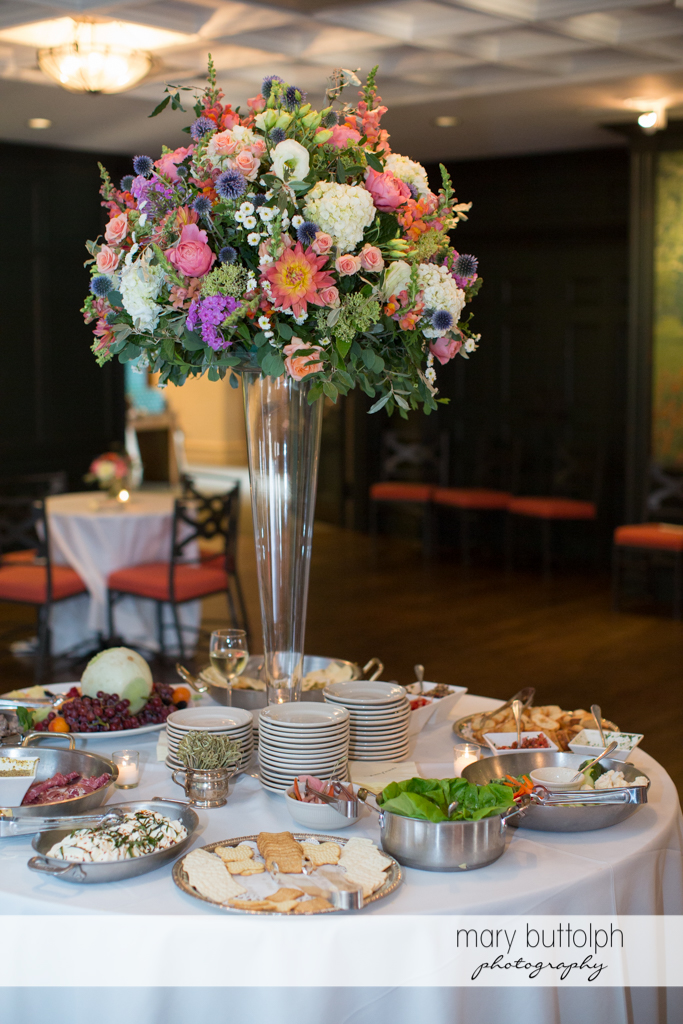 Beautiful bouquet towers above the food at the Inns of Aurora Wedding
