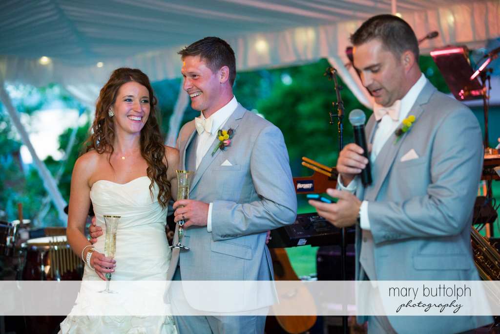 Couple and host preside over the wedding program at the Inns of Aurora Wedding