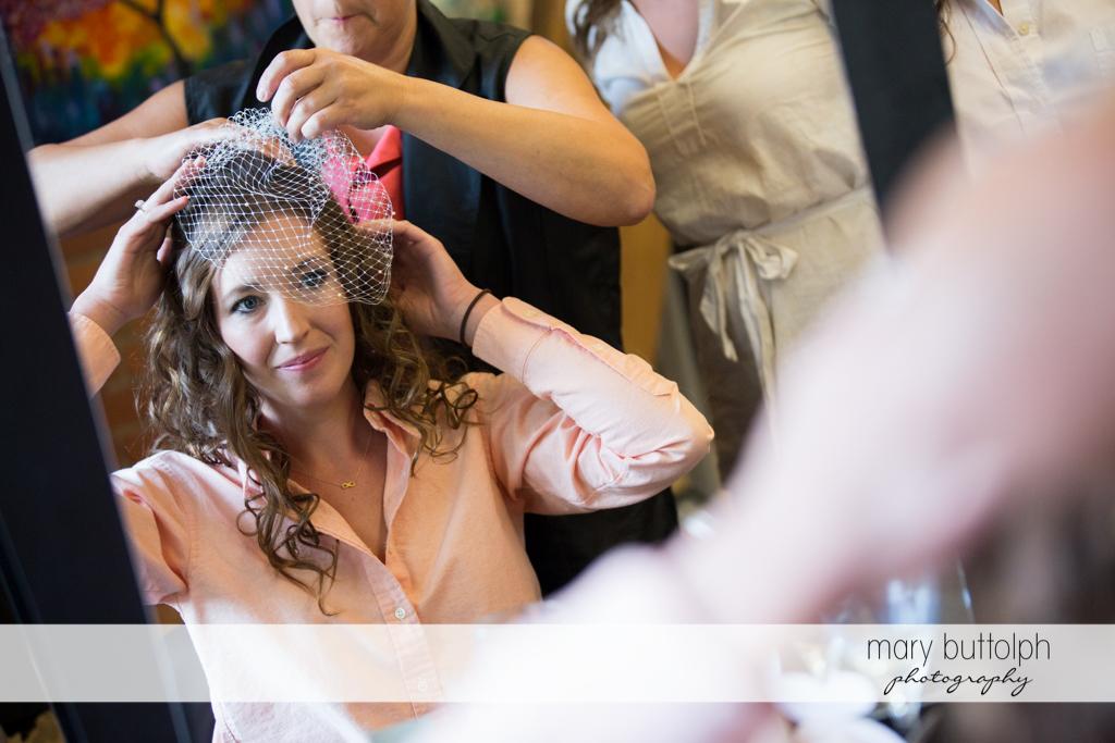 Bride tries on her wedding veil at the Inns of Aurora Wedding