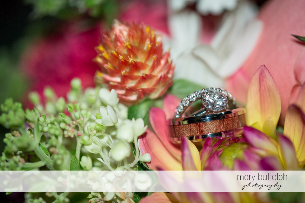 Couple's wedding rings sits on flowers at the Inns of Aurora Wedding