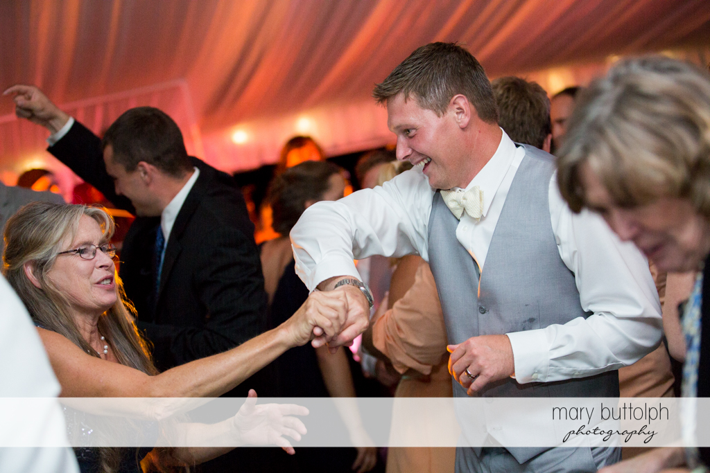 Groom dances with a guest at the Inns of Aurora Wedding