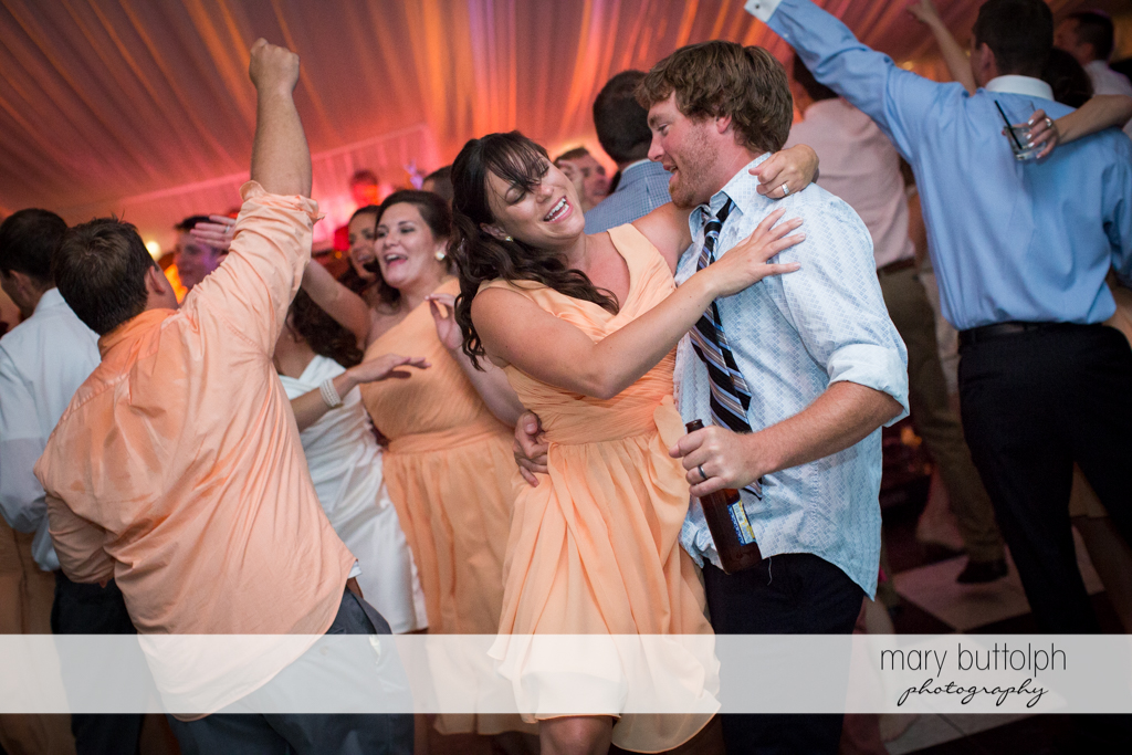 Guests party after the wedding at the Inns of Aurora Wedding