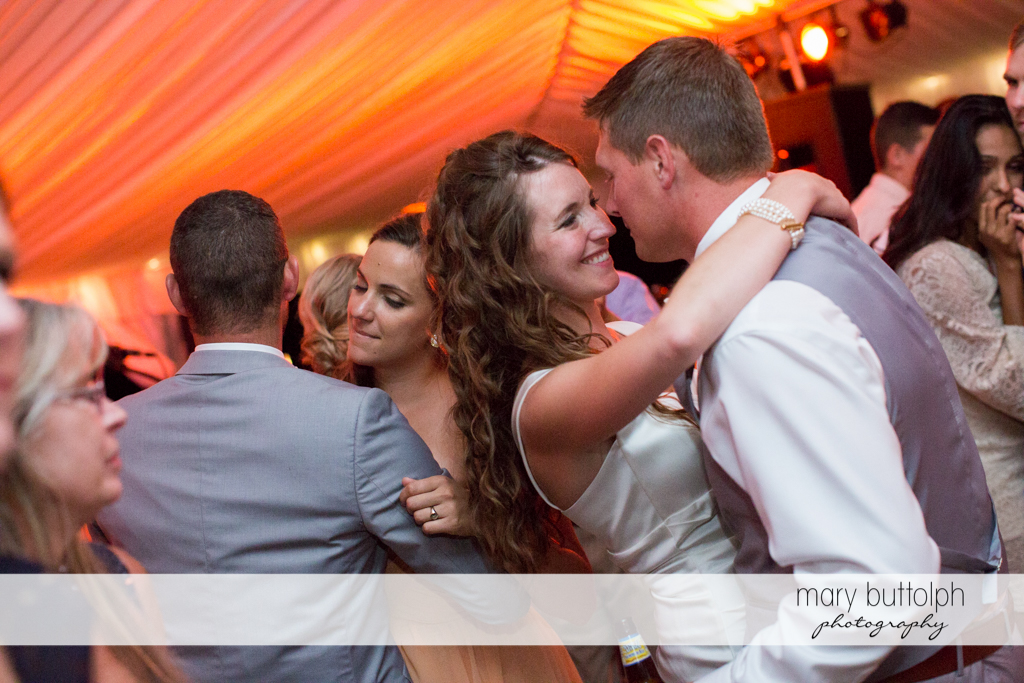 Couple dance with guests at the Inns of Aurora Wedding