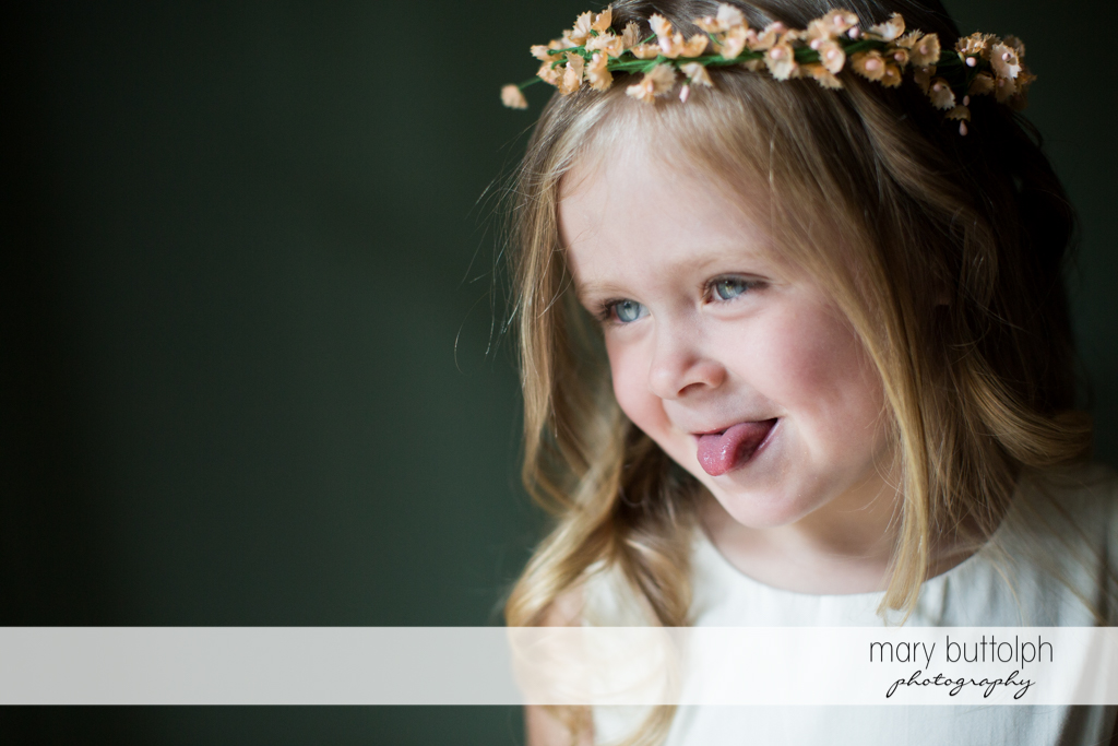 Young girl sticks out her tongue at Arrowhead Lodge Wedding