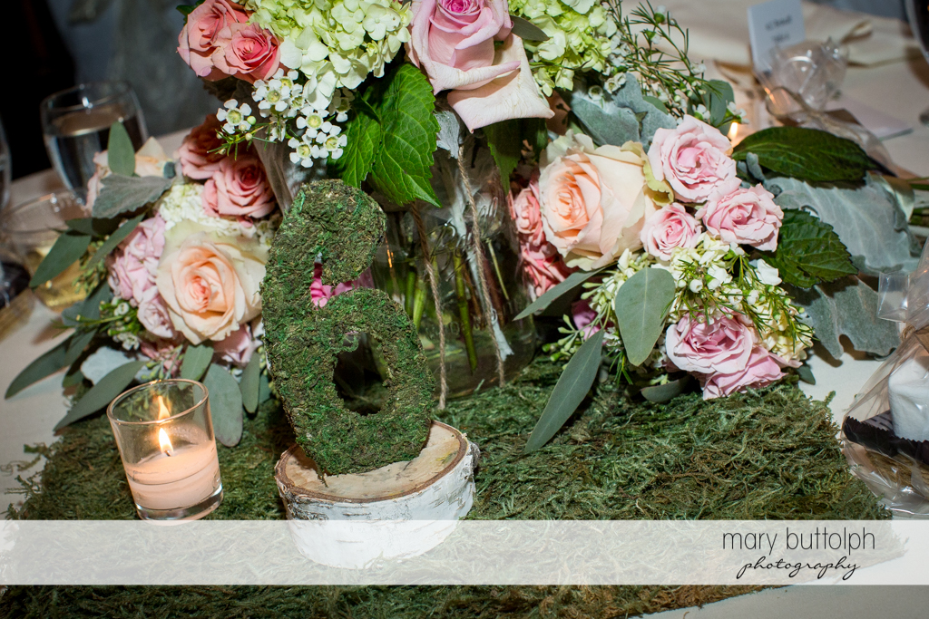 Numbered table with bouquets at Arrowhead Lodge Wedding